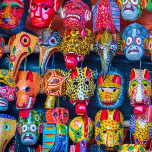 mayan-wooden-masks-for-sale-at-chichicastenango-market-in-guatemala-F25550